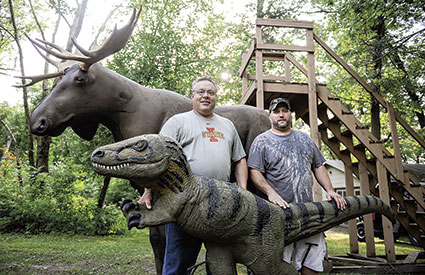 Troy Hawkshead and Matt Streiff pose with just two of the 3D targets at the Cedar River Archery Club. The two board members are hoping to attract more youth to the sport.