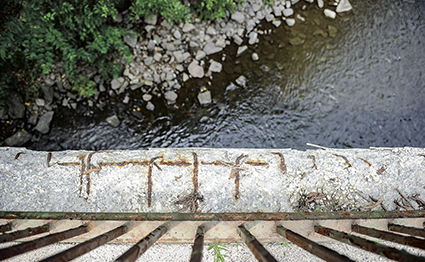 Rusted rebar is visible on the Oakland Place Southeast bridge just off the East Side Lake dam Tuesday.