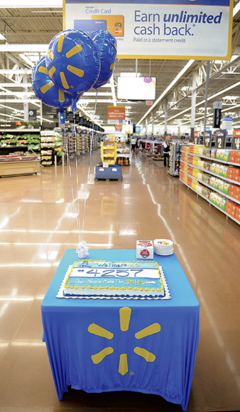 Cake sits at the entrance celebrating the Wal-Mart store's grand re-opening Friday morning.