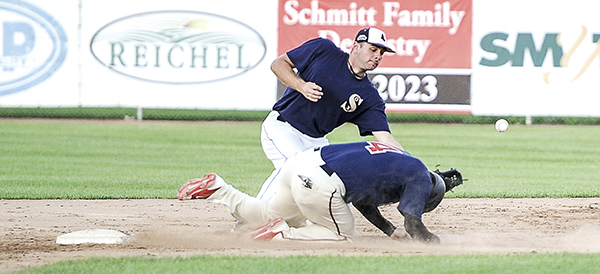 The Blue Sox Brady Banse tries to field ball as the Greyhounds' Tyler Nelson slides into second Friday night at Marcusen Park. Eric Johnson/photodesk@austindailyherald.com