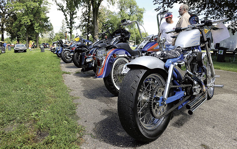 Motorcycle's are lined up for attendees.