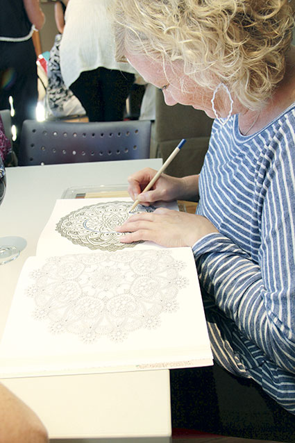 Nan Hanegraaf works on her piece during the event.
