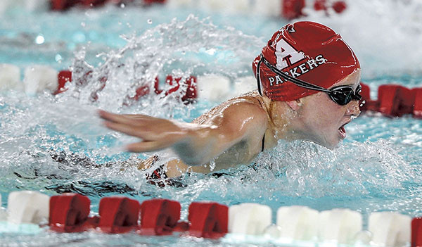 Austin's Molly Sheehan swims the butterfly portion of the 200 intermediate relay Friday night at Bud Higgins Pool. Eric Johnson/photodesk@austindailyherald.com