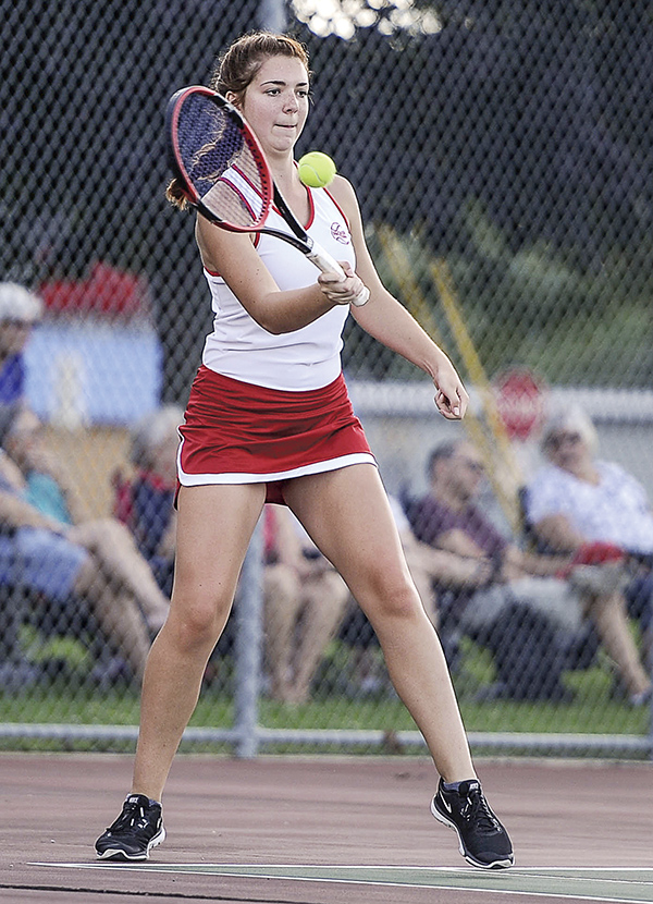 Austin's Kellie Baier returns a ball during the No. 1 doubles match against Faribault Tuesday afternoon at Paulson Courts. Eric Johnson/photodesk@austindailyherald.com
