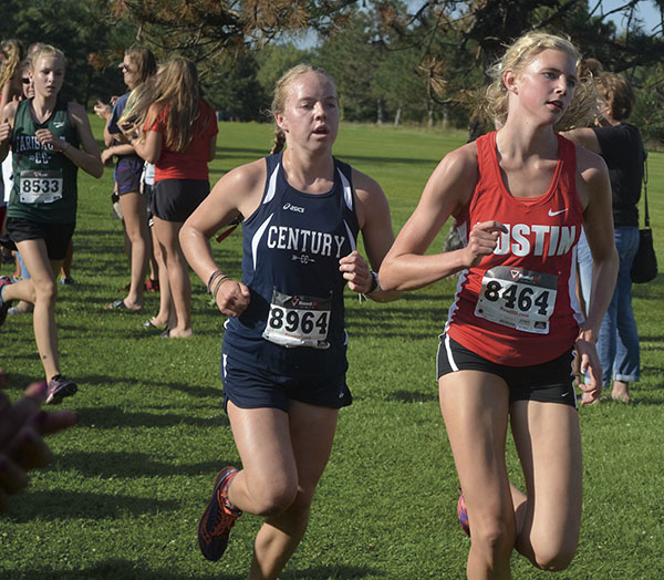 Austin's Abby Lewis runs in the season opening cross country invite at Meadow Greens golf course Tuesday. Rocky Hulne/sports@austindailyherald.com