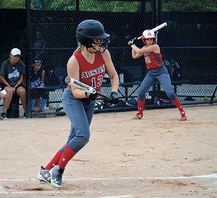 Destiny Gray sets up to lay down a bunt for the Austin 14U softball team. Photo Provided