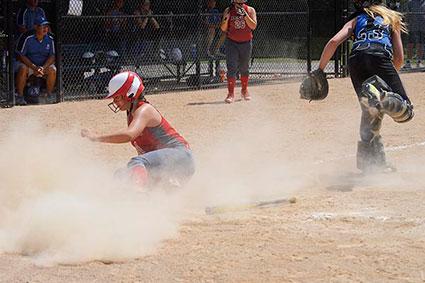 Zoe Dolan-Peterson slides home for the Austin 14U softball team. Photo Provided