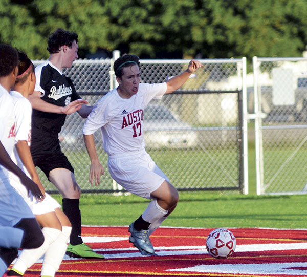 Matias Parada controls the ball for the Packers near the goal against Plainview-Elgin-Millville in Art Hass Stadium Monday. Rocky Hulne/sports@austindailyherald.com