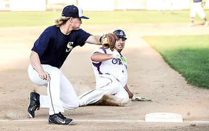 Parker Mullenbach moves to make a tag on a stolen base attempt at third against Savage Wednesday night at Marcusen Park. Eric Johnson/photodesk@austindailyherald.com