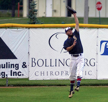 Brandon Rector makes a leaping catch in right field for the Austin Blue Sox in Marcusen Park Monday. Rocky Hulne/sports@austindailyherald.com