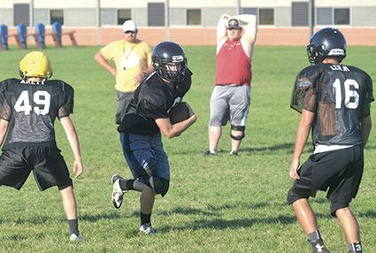 Seth Peterson carries the ball for the Blooming Prairie football team in practice.