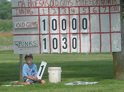 Easton Meyer mans the scoreboard at Hamm's field near Lyle. Rocky Hulne/sports@austindailyherald.com