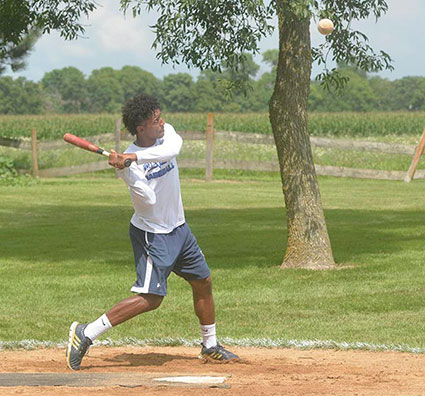 Ricky Marinez takes a swing at Hamm's field on the Meyer farm near Lyle. Rocky Hulne/sports@austindailyherald.com