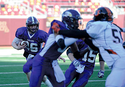 Christopher Bain carries the ball for Grand Meadow in the Class nine man state championship game against Underwood last fall. Bain had 1,786 total yards of offense, 26 TDs and 116 tackles last season for GM. Herald File Photo