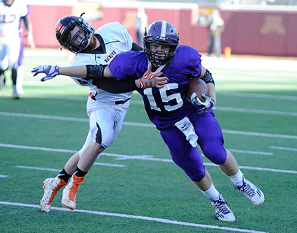 Zach Myhre shakes off an Underwood defender in the Class nine man state title game in TCF Bank Stadium in Minneapolis last fall. Myhre had 810 yards of offense, 12 TDs and 91 tackles last fall. Herald File Photo