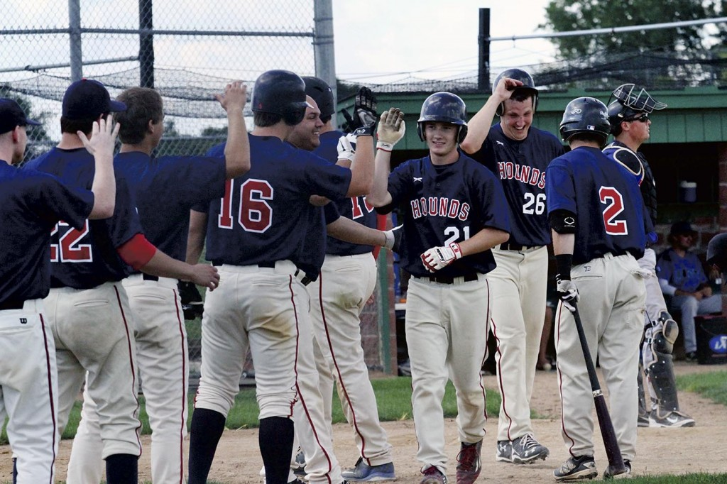 The Austin Greyhounds congratulate Nate Conner on his three-run homer in Eagan Sunday. The Hounds will open state tournament play in Lichfield Saturday. Photo Provided by Mary Nelson