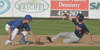 Andrew Schumacher slides into second base for the Austin Post 1216 VFW baseball team gainst Rochester Century in Marcusen Park Tuesday. Rocky Hulne/sports@austindailyherald.com
