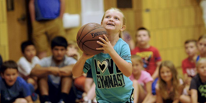 Isabelle Sellers, a 9-year old from Austin, attempts a shot at the Minnesota Timberwolves Caravan in the YMCA Monday. Rocky Hulne/sports@austindailyherald.com