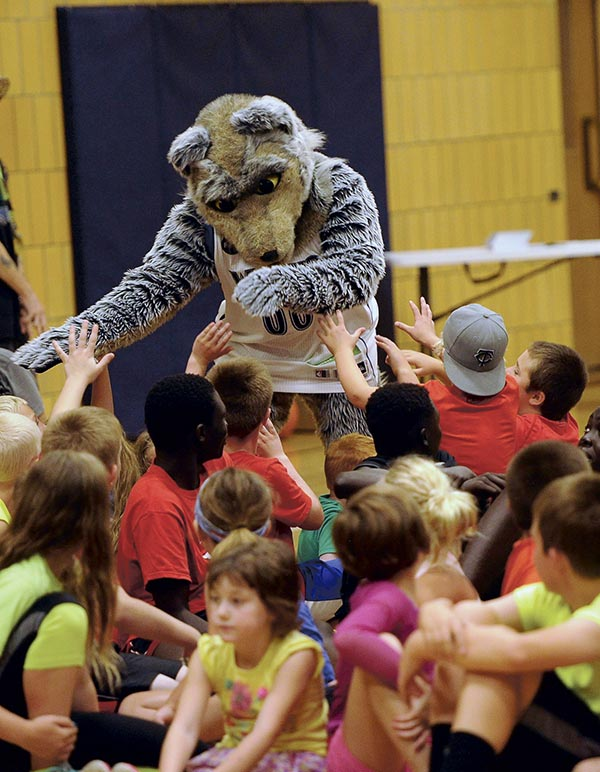 Timberwolves mascot ��Crunch' makes a grand entrance at the Timberwolves Caravan in the YMCA Monday. Rocky Hulne/sports@austindailyherald.com