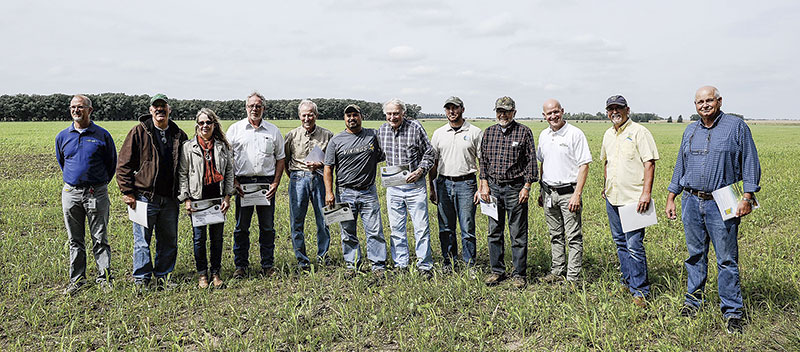Farmers are recognized for receiving the state's Agricultural Water Quality Certification Thursday afternoon. Tour attendees, from left: Bill Fitzgerald, Scott Marpe, Diane Honsey, Mark Ditlevson, James Anderson, Tom Cotter, Michael Cotter, Jon Jovaag, Arvid Jovaag, Brad Redlin, Mark Root, Larry Peterson.