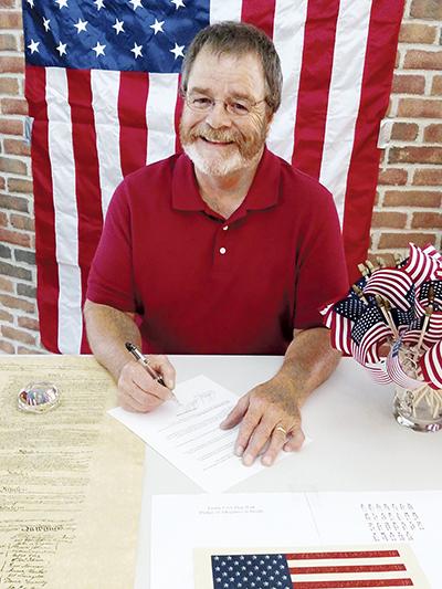 Mayor Tom Stiehm signs a Constitution Week proclamation.