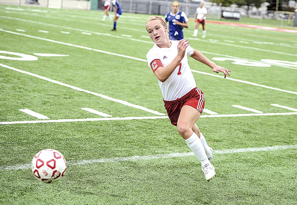 Austin's Paige Raymond chases the ball down during the first half against Mankato Loyola. Herald file photo