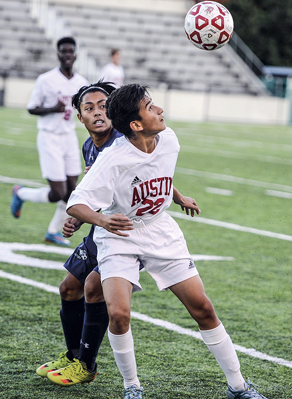 Austin's Kevin Ortiz follows the ball in during the first half against Rochester Century Tuesday night at Art Hass Stadium. Eric Johnson/photodesk@austindailyherald.com