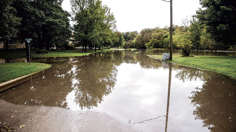 Water from the Turtle Creek overflows its banks and covers the intersection of 6th Avenue and 21st Street Southwest.