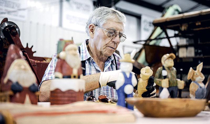 Woodcarver Myron Spindler shows off his craft.