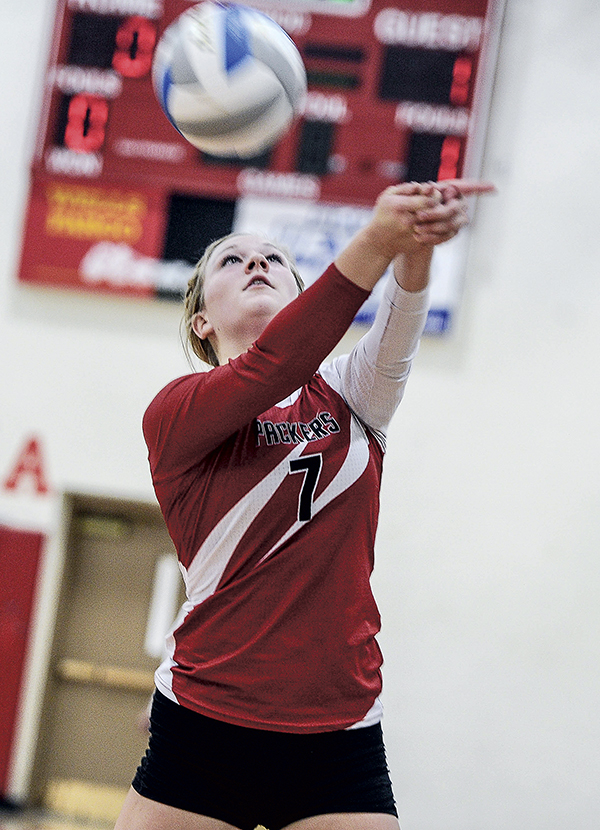 Austin's Jenna Braaten saves the ball from going out of bounds in game one against Northfield Thursday night in Packer Gym. Eric Johnson/photodesk@austidnailyherald.com