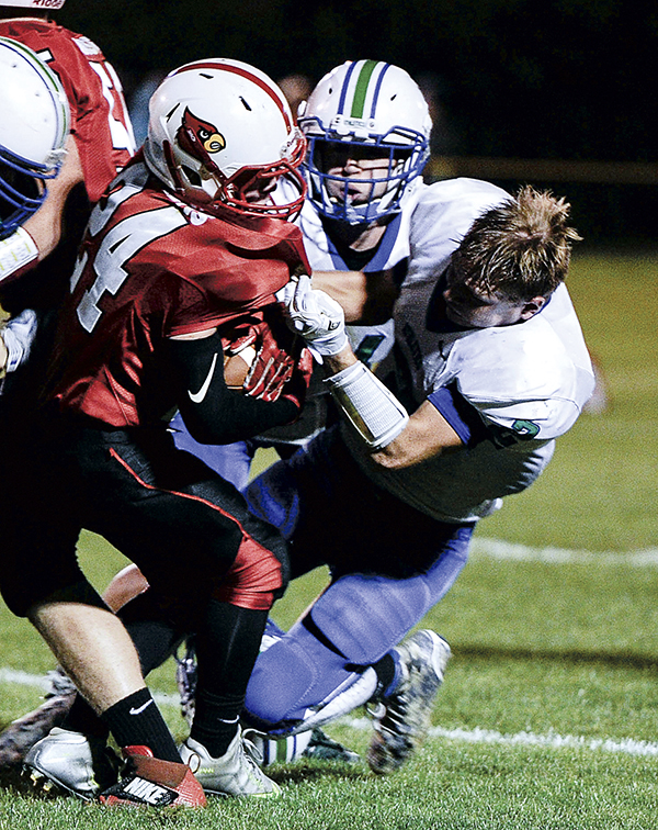 Lyle-Pacelli's Brady Lester loses his helmet while dragging down LeRoy-Ostrander's Jackson Hockens in the second quarter Friday night in LeRoy. Eric Johnson/photodesk@austindailyherald.com
