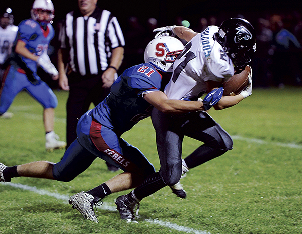 Southland's Chris Webber catches up and tackles Fillmore Central's Matt Lutes during the third quarter Friday night in Adams. Eric Johnson/photodesk@austindailyherald.com