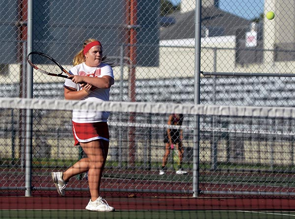 Austin's Emily Sayles makes a play on the ball in Paulson tennis courts Monday. Rocky Hulne/sports@austindailyherald.com