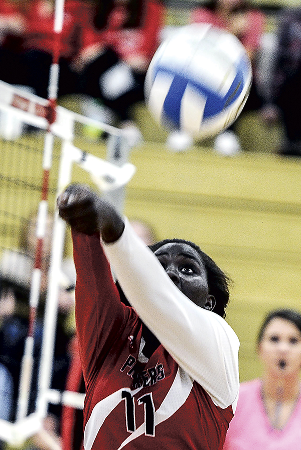 Austin's Awenia Nywesh chases down the ball in game one against Rochester Century Tuesday night in Packer Gym. Eric Johnson/photodesk@austindailyherald.com