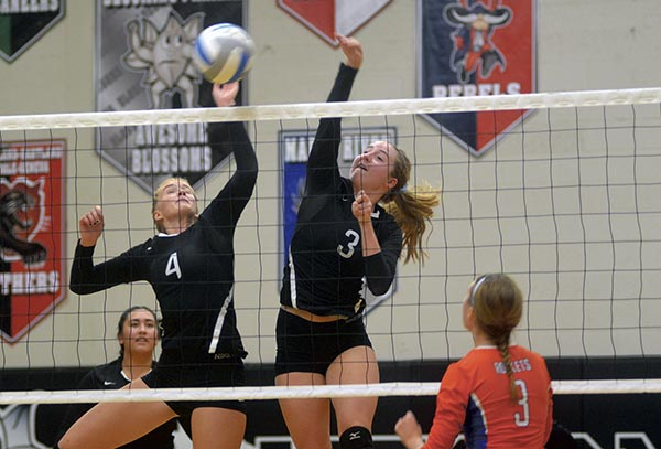 From left: Marissa Larson and Sam Wurst defend the net for Blooming Prairie against Randolph in BP Monday. Rocky Hulne/sports@austindailyherald.com