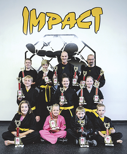 Impact Fitness had several places in the top three places at the state level championships including 13 champions. Pictured are front row, from left: Ava Wahlstrom, Addison Foote, Noah Graves and Briar Palumbo. Second row: Gabe Denhartog, Caitlin Lura and Katynne Fisher. Back row: Riley Maloney, Owen Wahlstrom, Troy Williams and Brian Wahlstrom. Not pictured: Robert Andrews and Madison Duenes.