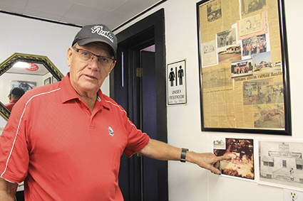 Bill Nicol points at an old picture of his family's past shop in Nicolville at Nicol's Fast Lube & Car Wash. Though the family closed its self service car last month, the Nicols are looking ahead to a bright future and some upkeep at Nicol's Fast Lube & Car Wash.