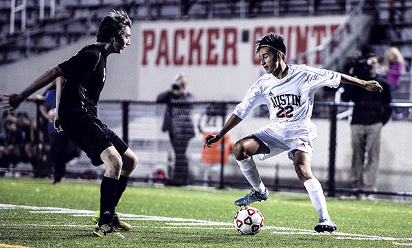 Austin's Kevin Ortiz plays the ball in Caledonia territory during the first half of their first-round matchup in the Section 1A Tournament Tuesday night at Art Hass Stadium. Eric Johnson/photodesk@austindailyherald.com