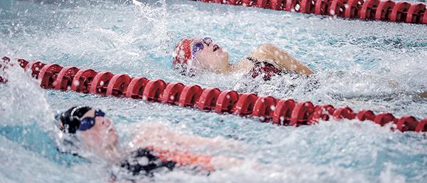 Austin's Emma Kleis opens the 200 medley relay in the back stroke against Winona Thursday night at Bud Higgins Pool. Eric Johnson/photodesk@austindailyherald.com