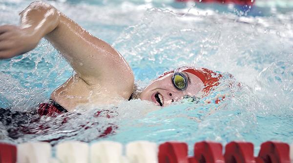 Austin's Zoe Dolan Peterson swims the 200 yard freestyle against Winona Thursday night at Art Hass Pool. Eric Johnson/photodesk@austindailyherald.com