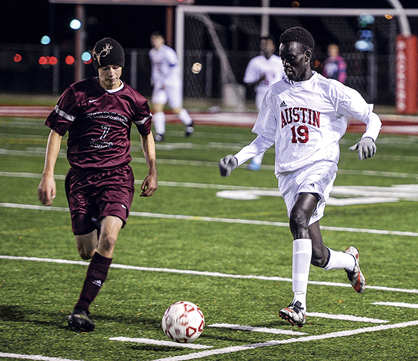 Austin's Lonyjera Okal races Pine Island/Zumbrota-Mazeppa's Brandon DePestel to the ball in the first half of their quarterfinal match-up in the Section 1A Tournament at Art Hass Stadium. Eric Johnson/photodesk@austindailyherald.com