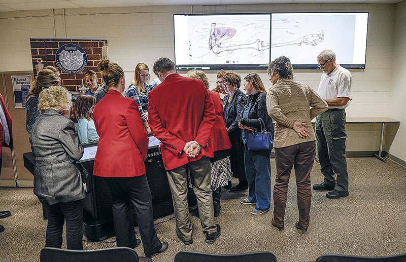 People gather around the Anatomage Table for a demonstration.