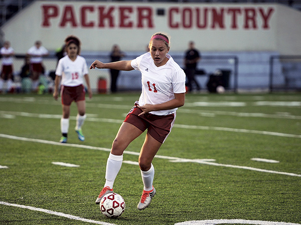 Sydney Marsh controls the ball for the Packers in Art Hass Stadium Monday. Rocky Hulne/sports@austindailyherald.com