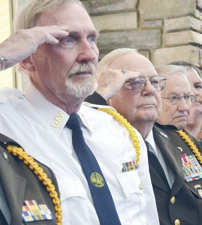 A line of veterans salute as they sang national anthem during ceremonies Friday at St. Mark's Living. Deb Nicklay/deb.nicklay@austindailyherald.com