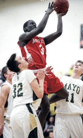 Austin's Moses Issa goes up in traffic during the second half against Rochester Mayo Thursday night in Packer Gym. Eric Johnson/photodesk@austindailyherald.com