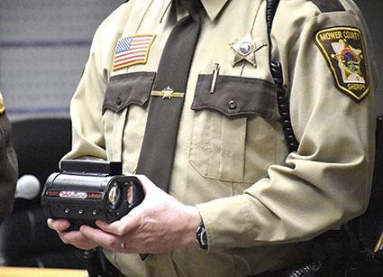 Mower County Deputy Jamie Meyer holds a lidar unit donated to the Mower County Sheriff's Office.  Jason Schoonover/jason.schoonover@austindailyherald.com