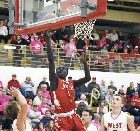Both Gach attacks the rim for the Packers against Mankato West in Packer Gym Monday. Rocky Hulne/sports@austindailyherald.com
