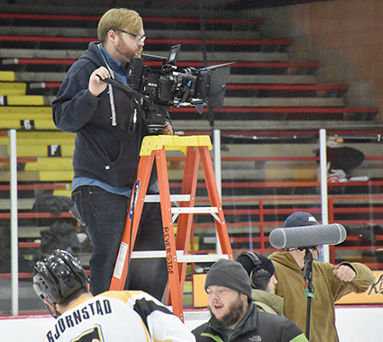"The cameraman readies for another scene of ""Ahocklypse"" at Riverside Arena. The Austin Bruins are providing their athletic ability to the film."