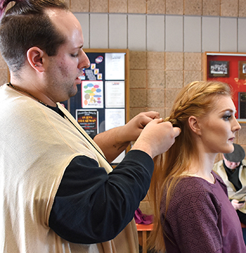 "Tanner J of St. Paul works on Gabrielle Arrowsmith's hair in her transformation for the film, ""Ahockalyse,"" filming at Riverside Arena."